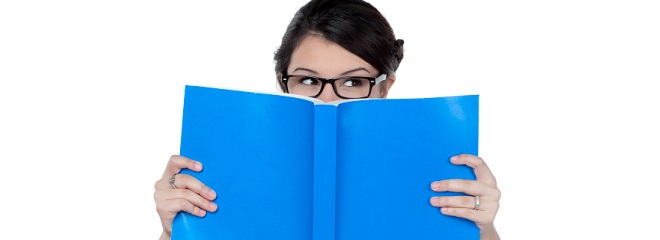 shy student covering her face by her book