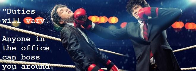 Businessmen boxing
