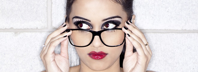 young indian female fashion model looking away while wearing spectacles