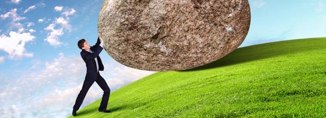 Man pushing stone